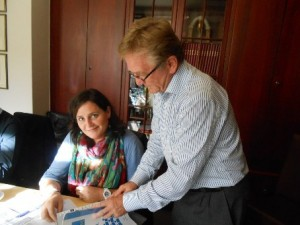 Snapshot from the session: Hans Jørgen Lorenzen (right) admires a publication from Murcia; left: Consuelo Garcia.
